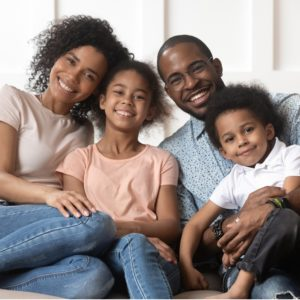 Portrait of black family with kids relax on couch